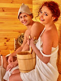 Couple in hat  at sauna Royalty Free Stock Photography