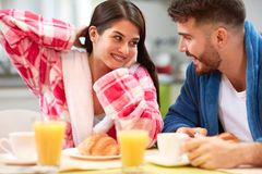 Couple have breakfast in kitchen royalty free stock photos