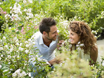 Couple have fun choosing flower. In a greenhouse Royalty Free Stock Photos