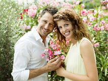 Couple have fun choosing flower pots in a greenhouse. Couple have fun choosing flower pots in spring Royalty Free Stock Image