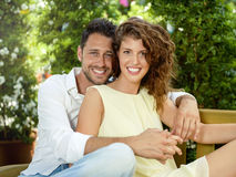 Couple have fun choosing flower pots in a greenhouse. In spring Stock Photography