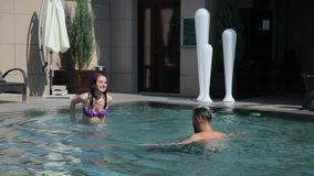 Couple have fun in the pool.  stock footage