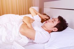 Couple have problem with man`s snoring on bed. Young couple have problem with man`s snoring on bed Stock Photos