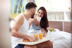 Couple have romantic breakfast in bed. Happy couple have romantic breakfast in bed Stock Photography