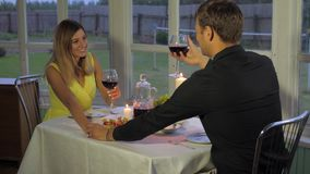 Happy Couple In The Evening For A Romantic Dinner, Holding Hands, Clink Glasses. Couple have a romantic evening with a candlelight dinner. Took each other`s hand stock video