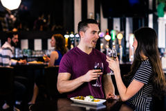 Couple having an aperitif with wine Stock Photography