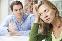 Couple Having Arguement At Home Stock Images