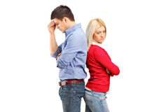 Couple after having an argument. Couple with their backs turned after having an argument isolated against white background Royalty Free Stock Photo