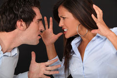 Couple having argument. Couple having a massive argument royalty free stock photography