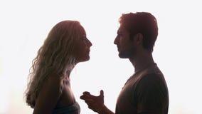 Couple having an argument against sunlight