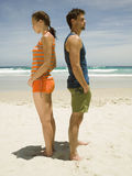 Couple having an argument on the beach. Royalty Free Stock Image