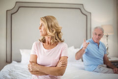 Couple having an argument in bedroom. At home Royalty Free Stock Photo