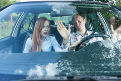 Couple having argument in car. Young couple having a fight while driving Stock Photo