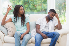 Couple having argument on the couch. At home in the living room Royalty Free Stock Photos