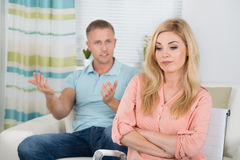 Couple Having Argument At Home. Photo of young couple having argument at home royalty free stock image