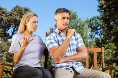 Couple having an argument on park bench Stock Image