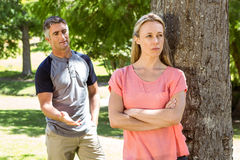 Couple having an argument in the park Stock Images