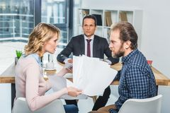 Couple having argument. Side view of couple having argument during meeting with lawyer in office royalty free stock photo