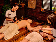 Couple having Ayurvedic spa treatment Royalty Free Stock Images