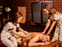 Couple having Ayurvedic spa treatment Stock Image