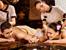 Couple having Ayurvedic spa treatment. Royalty Free Stock Image