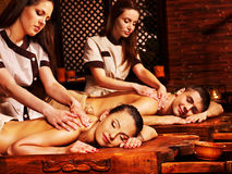 Couple having Ayurvedic spa treatment. Stock Image