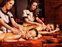 Couple having Ayurvedic spa treatment. Stock Image
