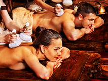 Couple having Ayurvedic spa treatment. Royalty Free Stock Photo
