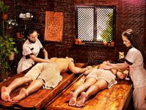 Couple having Ayurvedic spa treatment. Royalty Free Stock Photography