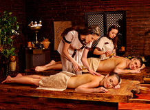 Couple having Ayurvedic spa treatment Stock Photo
