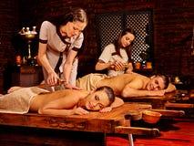 Couple having Ayurvedic spa treatment Stock Photo