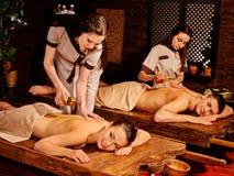 Couple having Ayurvedic spa treatment Stock Image