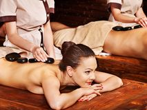 Couple having Ayurvedic spa treatment. Stock Photos