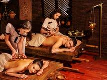 Couple having Ayurvedic spa treatment. Young family having oil Ayurveda spa treatment royalty free stock image