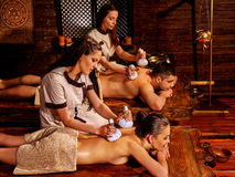Couple having Ayurvedic spa treatment. Young family having oil herbal Ayurveda spa treatment stock images
