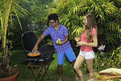 Couple having a barbeque Stock Image
