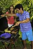 Couple having a barbeque Stock Photo
