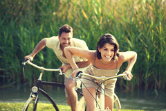 Couple having a bicycles race into the nature in Garda Lake Stock Photos