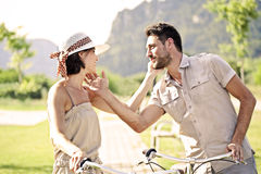 Couple having a bicycles ride into the nature Stock Images