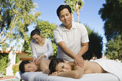 Couple Having A Body Massage Royalty Free Stock Photo