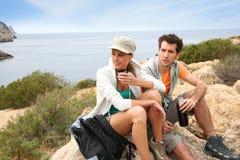 Couple having a break on island stock photography