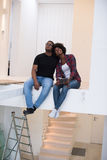 Couple having break during moving to new house Stock Photography