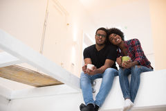 Couple having break during moving to new house Stock Photos