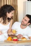 Couple having breakfast Stock Photos