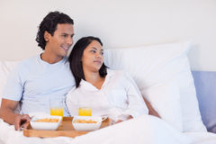 Couple having breakfast in the bed Stock Photo