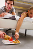 Couple having breakfast in bed Stock Photography