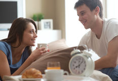 Couple having breakfast in bed Royalty Free Stock Image