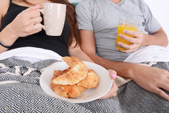 Couple having breakfast in bed. Royalty Free Stock Photography