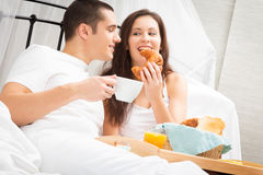 Couple Having Breakfast In Bed Stock Photos