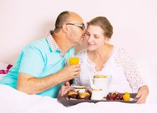 Couple having breakfast in bed Royalty Free Stock Images